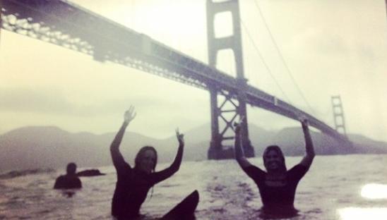 Lyndsay Noyes and Sage Erickson surf under the Golden Gate Bridge Photo: Instagram @__noyes__